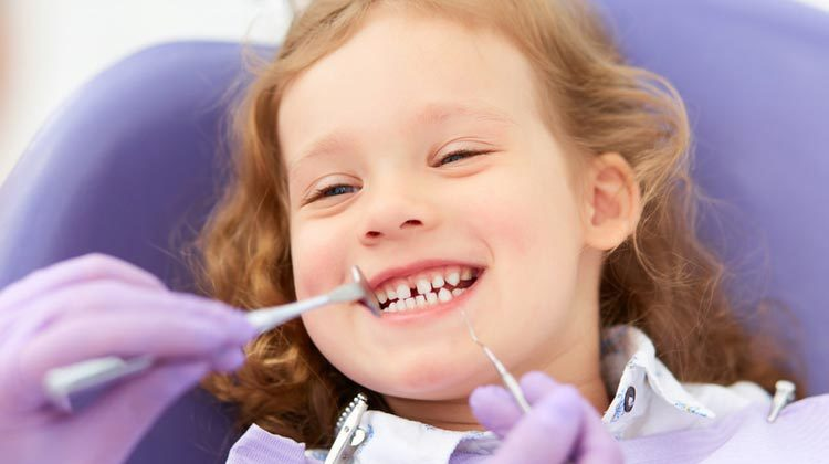 Child Smiling Dentist
