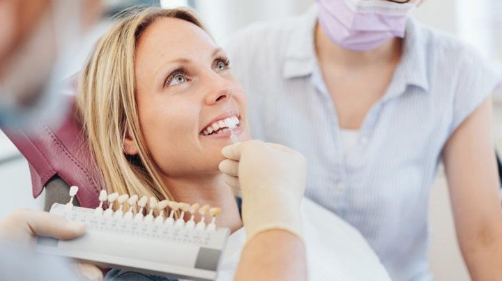 woman testing dental veneers