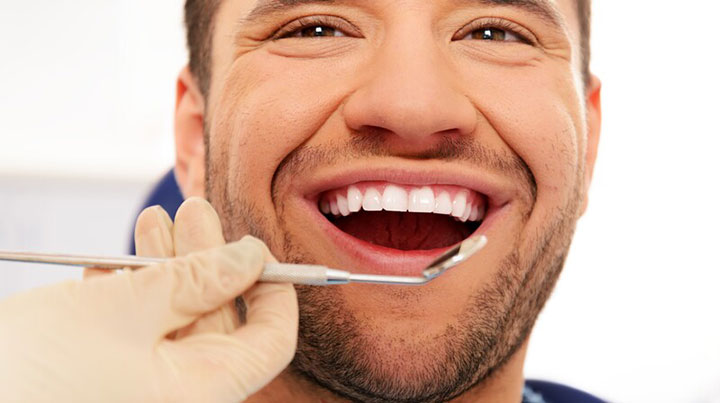 Man Smiling with Dead Tooth